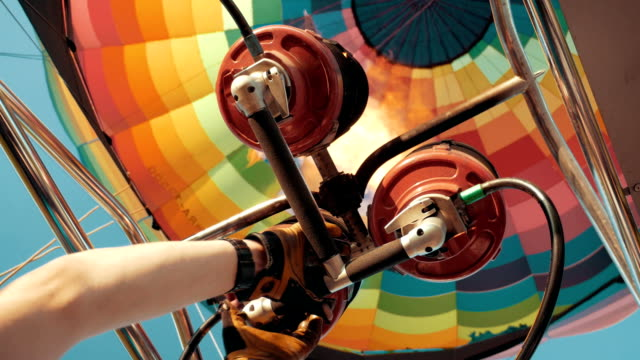 Hot air burning by gas fire to air balloon or aerostat during flight video