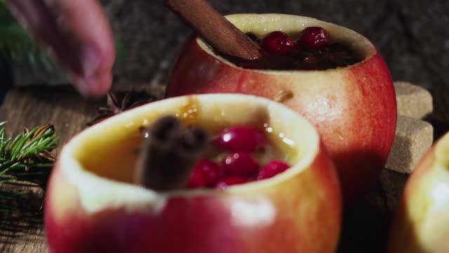 hot apple cider in apple cups - bevanda calda video stock e b–roll