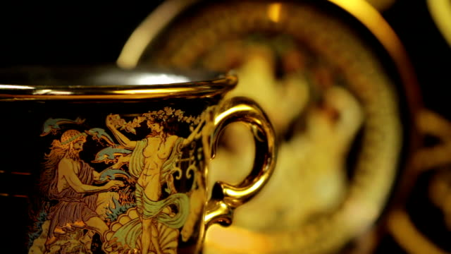 Hot aromatic  coffee in a beautiful gold cup video
