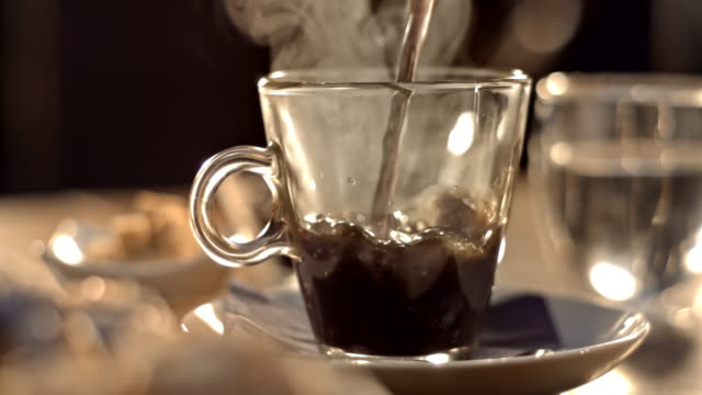 SLO MO LD Hot beverage being poured into a glass cup video