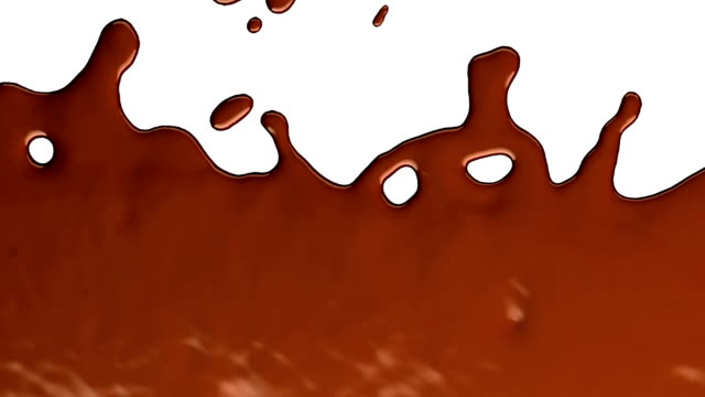 hot chocolate or cocoa drink slow motion flow and splashes - cioccolato video stock e b–roll