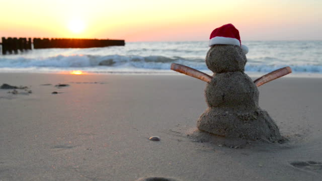 Hot Christmas Vacation Sandy snowman with santa hat snowman stock videos & royalty-free footage