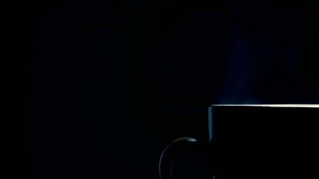 hot coffee cup on black background - tea cup stock videos & royalty-free footage