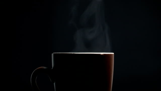 Hot coffee cup on black background Hot coffee cup on black background steam stock videos & royalty-free footage