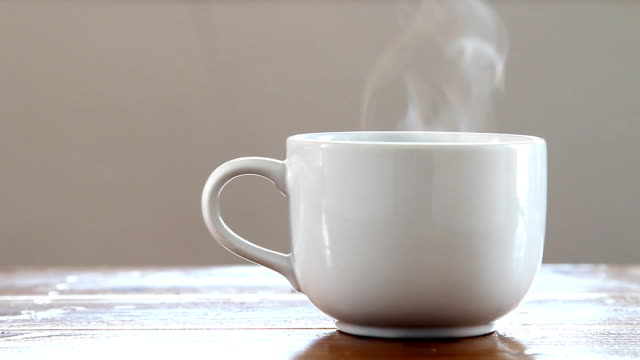 Hot coffee cup. Hot coffee cup with smoke. coffee cup stock videos & royalty-free footage