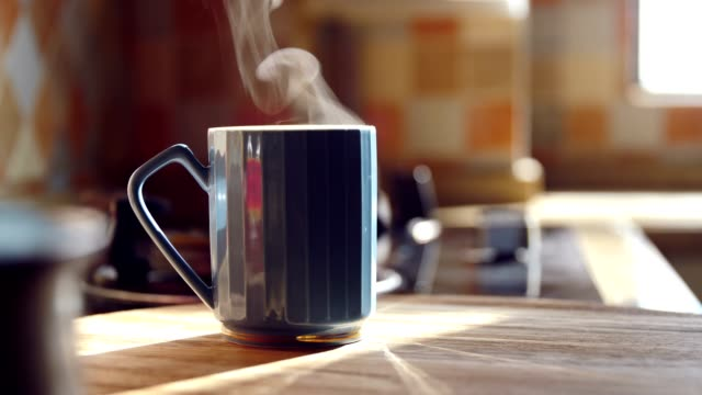 Hot coffee with steam on table Hot coffee with steam on table mug stock videos & royalty-free footage