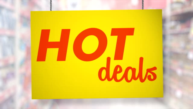Hot deal sign hanging from ropes. Luma matte included so you can put your own background.