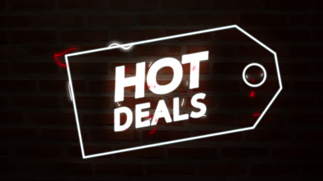 hot deals colorful neon liquid text glow bright light motion graphic on brick background and black background - sales video stock e b–roll