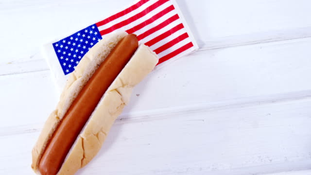 Hot dog on wooden table with 4th july theme video