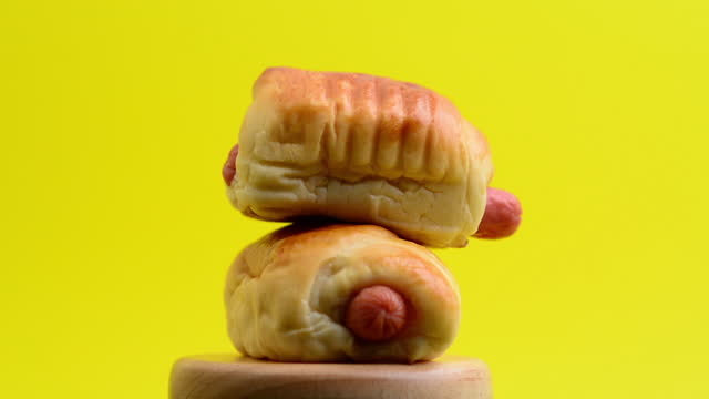 Hot dogs and hands, the hand that touches the bread and picks up the food Video about choosing foods that are good for your body