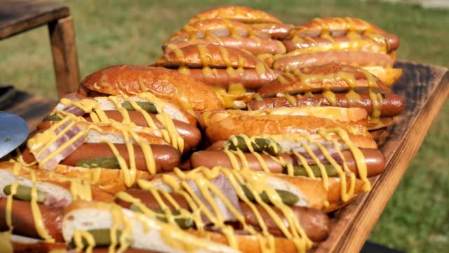hot dogs for a buffet - фуршет стоковые видео и кадры b-roll