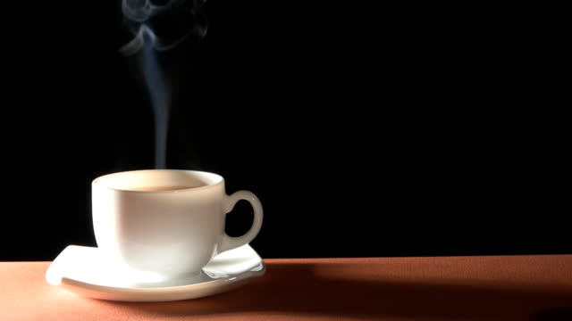 Hot drink Cup of hot drink with steam over black background coffee break stock videos & royalty-free footage