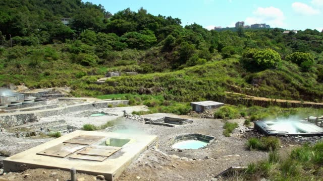 4k hot geothermal spring water steaming from terraces in yang ming shan - ming video stock e b–roll