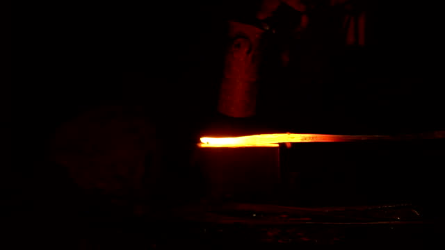 hot metal workpiece for the manufacture of clad steel on the anvil - spranga video stock e b–roll