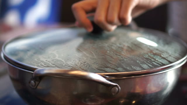 Hot pot, shabu lid cover remove with hand. Steam gushing out from boiled water video