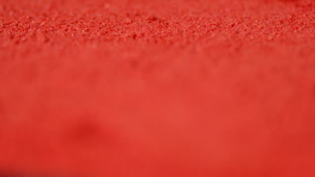 Hot red ground Chili pepper. Macro background. Hot red ground Chili pepper. Macro background. The texture of the pepper. handful stock videos & royalty-free footage