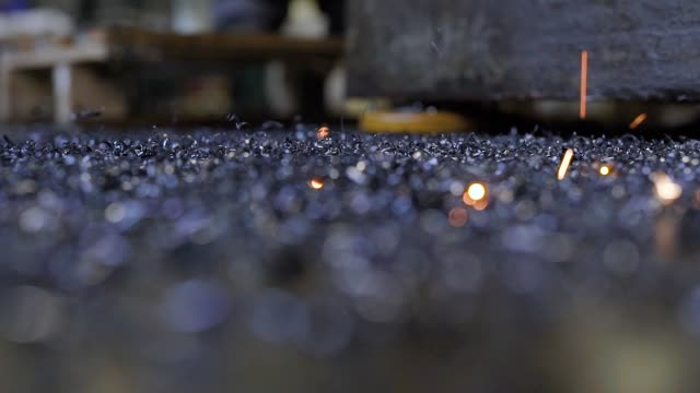 hot sparkles of welding machine are falling on a black dirty floor of workshop of metalworking plant, close-up hot sparkles of welding machine are falling on a black dirty floor of workshop of metalworking plant, close-up view from ground stick plant part stock videos & royalty-free footage