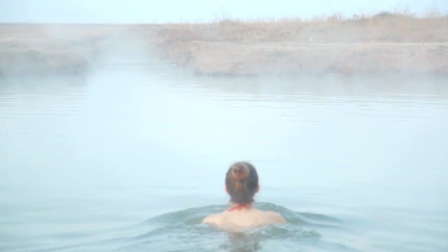 hot spring at sunrise, woman bathing, Genichesk, Ukraine hot spring at sunrise, woman bathing, Genichesk, Ukraine spa treatment stock videos & royalty-free footage
