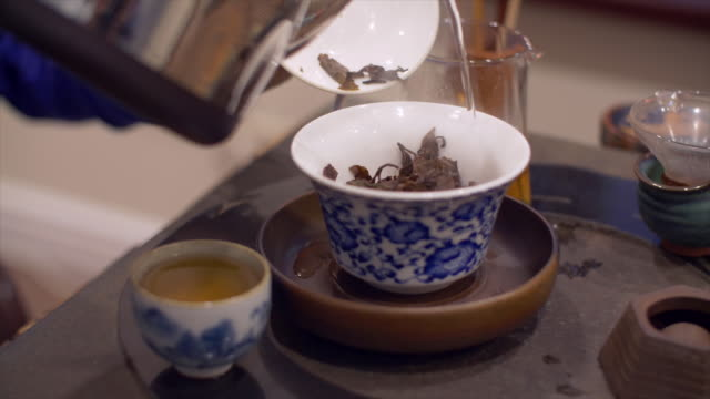 hot steaming water pouring into beautiful porcelain bowl - porcellana video stock e b–roll