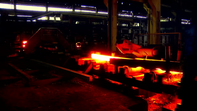 Hot steel on conveyor. Pouring out of the melted metal in a form video