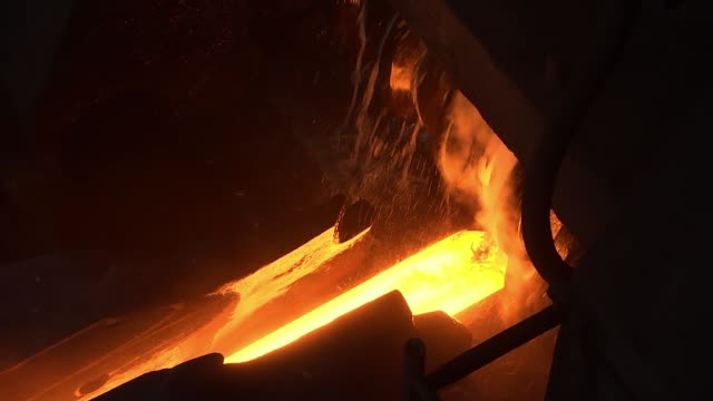 hot steel rail on a conveyor in a metallurgical plant - acciaio video stock e b–roll