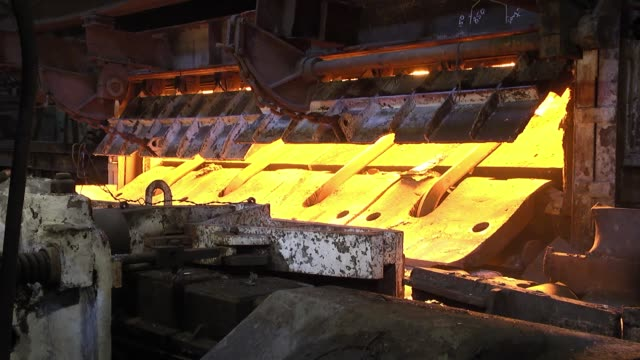 Hot steel rail on a conveyor in a metallurgical plant