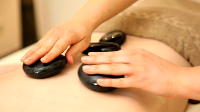 gorący kamienia leczenie - terapia lastone filmów i materiałów b-roll