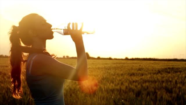 Hot Summer Sunset Woman Drinking Water Tired Runner video