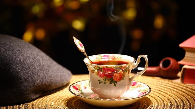 hot tea cup gold bokeh hat smoking pipe book nobody hd footage - teapot stock videos & royalty-free footage