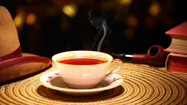 hot tea cup gold bokeh hat smoking pipe book nobody hd footage - teiera video stock e b–roll