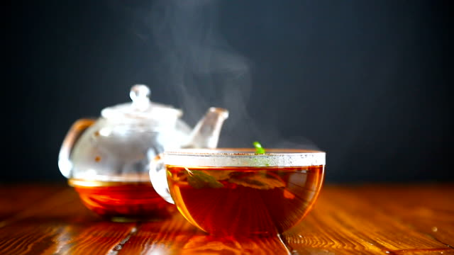 hot tea in a glass teapot - tea cup stock videos & royalty-free footage