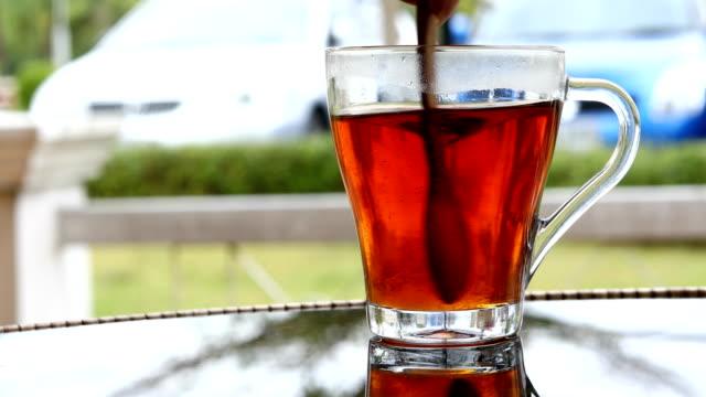Hot tea, spoon stirring sugar in tea video