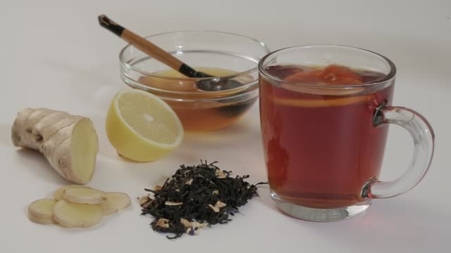 Hot tea with lemon Hot herbal tea with natural gifts lemon ginger honey ginger spice stock videos & royalty-free footage