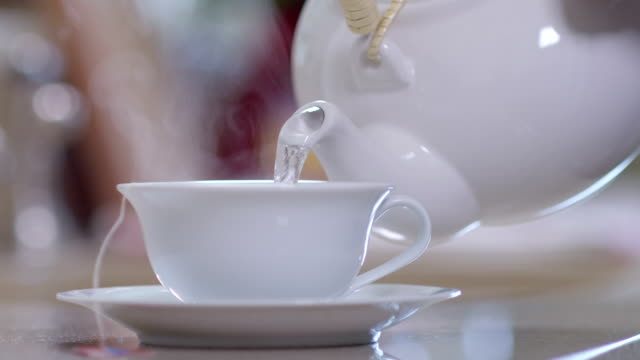 Hot water pour into a tea cup video