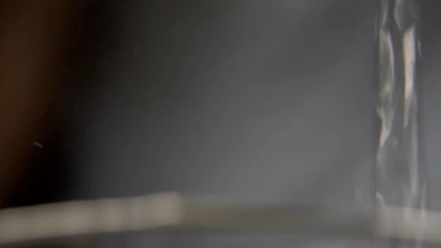 hot water pouring in a glass macro shoot - teiera video stock e b–roll