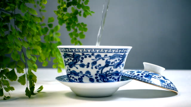 hot water pouring in chinese traditional tea cup - porcelain stock videos & royalty-free footage
