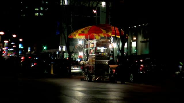 Hotdog stand at night in NYC USA video