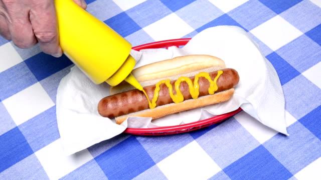 Hotdog with ketchup and mustard video