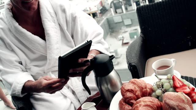 SLOW MOTION - Hotel Couple Breakfast Wireless SLOW MOTION - Hotel Couple Breakfast Wireless, Los Angeles California. newlywed stock videos & royalty-free footage