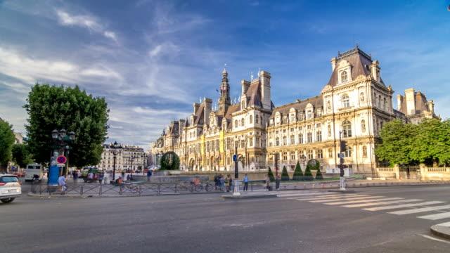 hotel de ville or paris city hall timelapse hyperlapse in sunny day - quartiere generale video stock e b–roll