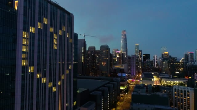 Hotel Heart Windows in San Francisco Stock 4k resolution UHD video of empty hotel rooms in San Francisco displaying window lit up in a hearts across the city with the Salesforce tower in the background. american architecture stock videos & royalty-free footage