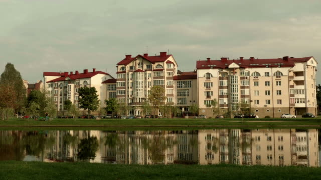 Hotel on the river. Autumn daytime. Smooth dolly shot.