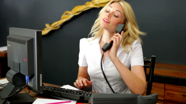 Hotel Receptionist Using Computer And Phone video