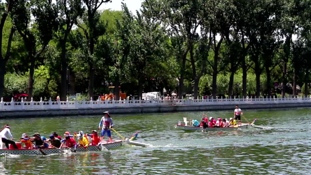 Houhai park at daytime HD. Beijing, China – June 28th, 2014:The view of Houhai park, some pleasure-boat sailing on the lake. competition group stock videos & royalty-free footage