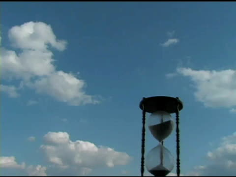 Hour Glass with Clouds Time Lapse 2