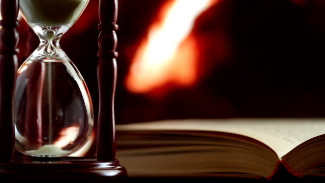 hourglass and book video