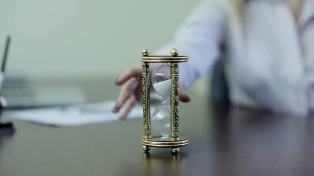 Hourglass at office desk video