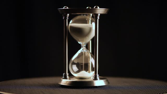 Hourglass. Clock. Glass Hourglass as time passing concept for business deadline, urgency and running out of time. hourglass stock videos & royalty-free footage