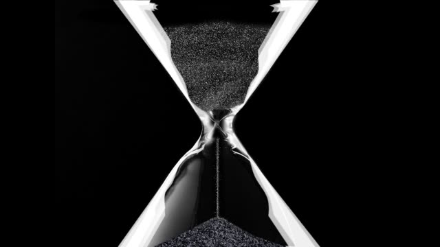 Hourglass closeup over black Sands move through sandglass. Animation hourglass stock videos & royalty-free footage
