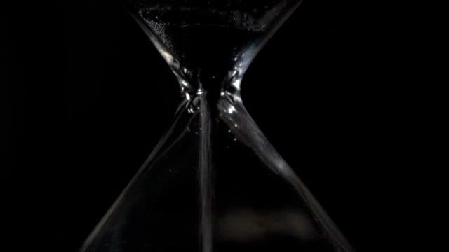 Hourglass closeup slow motion video